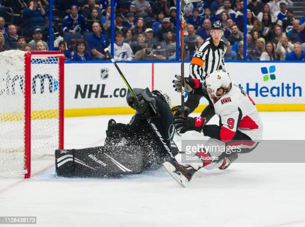 Goalie Andrei Vasilevskiy of the Tampa Bay Lightning makes a save against against a falling Bobby Ryan of the Ottawa Senators during the second...