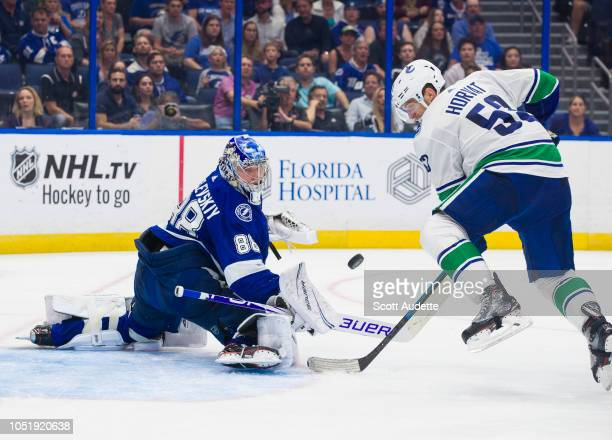 Goalie Andrei Vasilevskiy of the Tampa Bay Lightning makes a save against Bo Horvat of the Vancouver Canucks during the second period at Amalie Arena...