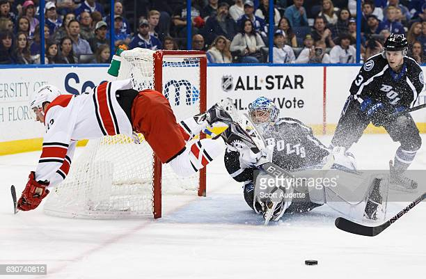 Goalie Andrei Vasilevskiy of the Tampa Bay Lightning makes a save against Derek Ryan of the Carolina Hurricanes during second period at Amalie Arena...