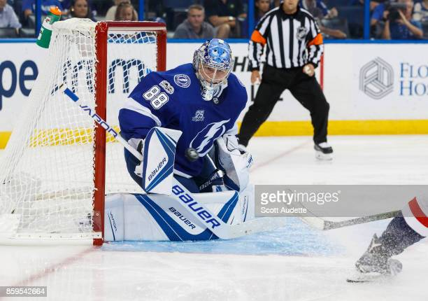 Goalie Andrei Vasilevskiy of the Tampa Bay Lightning makes a save against the Washington Capitals during the second period at Amalie Arena on October...
