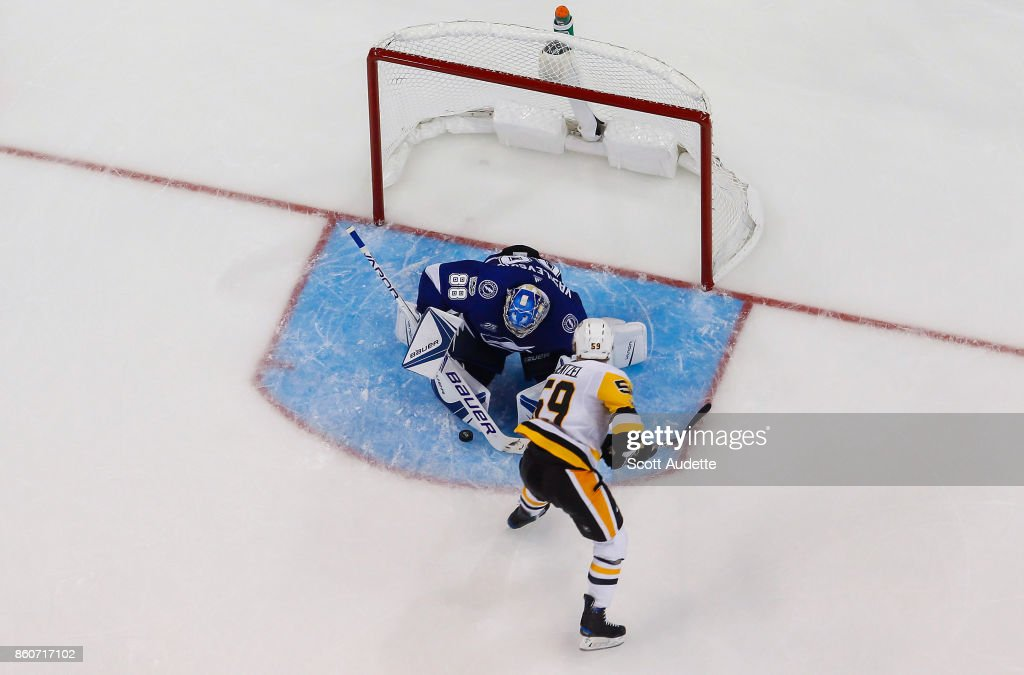 Goalie Andrei Vasilevskiy #88 of the Tampa Bay Lightning makes a save against Jake Guentzel #59 of the Pittsburgh Penguins during the third period at Amalie Arena on October 12, 2017 in Tampa, Florida.