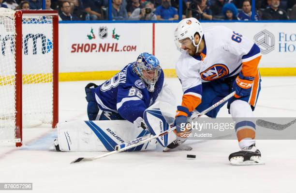 Goalie Andrei Vasilevskiy of the Tampa Bay Lightning makes a save against Joshua HoSang of the New York Islanders during the second period at Amalie...