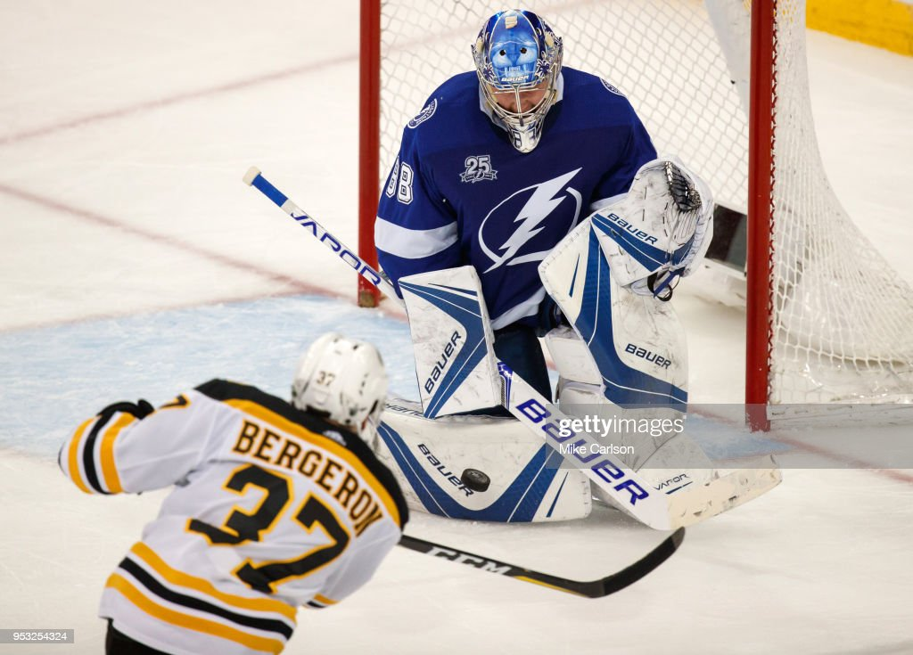 Goalie Andrei Vasilevskiy #88 of the Tampa Bay Lightning makes a save against Patrice Bergeron #37 of the Boston Bruins during Game Two of the Eastern Conference Second Round during the 2018 NHL Stanley Cup Playoffs at Amalie Arena on April 30, 2018 in Tampa, Florida.