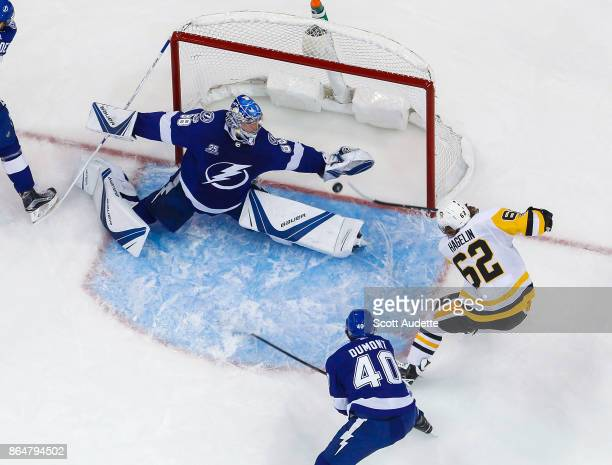 Goalie Andrei Vasilevskiy of the Tampa Bay Lightning stretches to make a save against Carl Hagelin of the Pittsburgh Penguins during the first period...