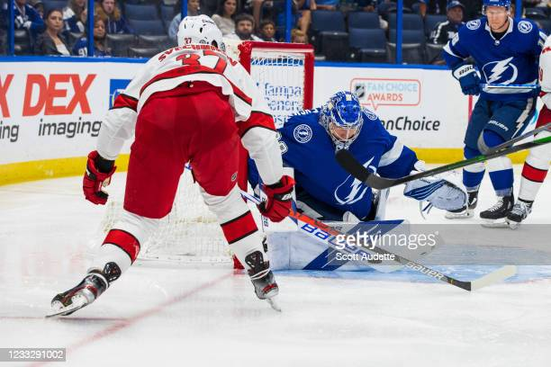Goalie Andrei Vasilevskiy of the Tampa Bay Lightning tends net against Andrei Svechnikov of the Carolina Hurricanes during the second period in Game...