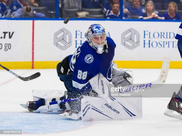 Goalie Andrei Vasilevskiy of the Tampa Bay Lightning watches a flying puck against the Florida Panthers during overtime at Amalie Arena on October 6...