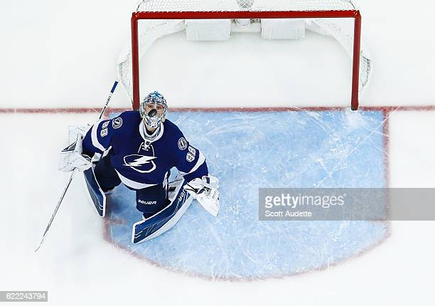 Goalie Andrei Vasilevskiy of the Tampa Bay Lightning watches the puck as it flies over his head against the New York Islanders during the third...