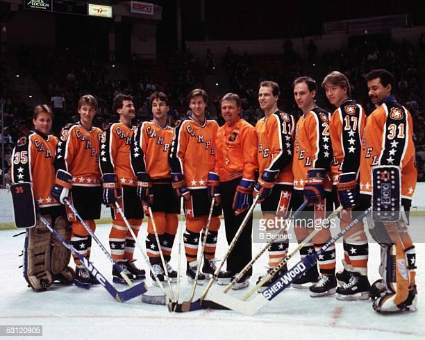 Goalie Andy Moog Wayne Gretzky Glenn Anderson Paul Coffey Kevin Lowe head coach Glen Sather Mark Messier Lee Fogolin Jari Kurri and goalie Grant Fuhr...