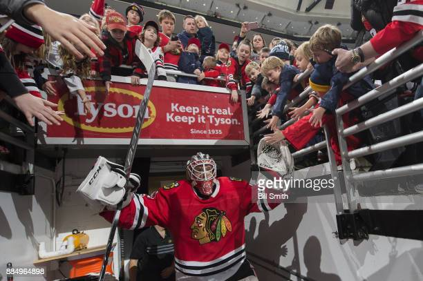 Goalie Anton Forsberg of the Chicago Blackhawks walks out of the tunnel prior to the game against the Los Angeles Kings at the United Center on...