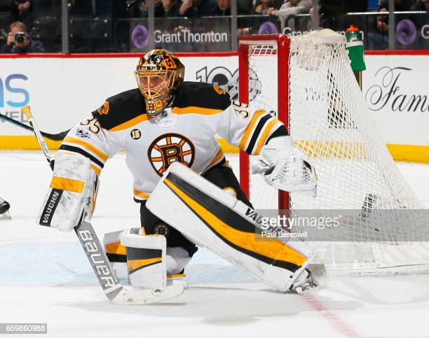 Goalie Anton Khudobin of the Boston Bruins defends the goal in an NHL hockey game against the New York Islanders at the Barclays Center on March 25...