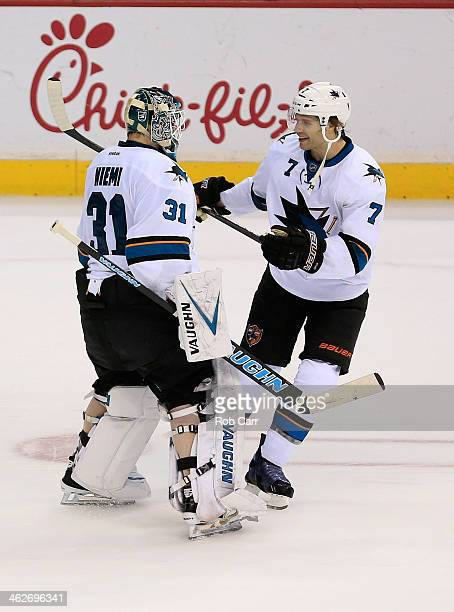 Goalie Antti Niemi and Brad Stuart of the San Jose Sharks celebrate following the Sharks 21 shootout win over the Washington Capitals at Verizon...
