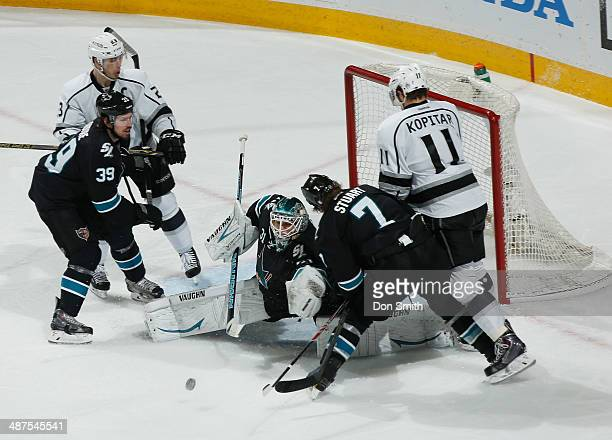 Goalie Antti Niemi Brad Stuart and Logan Couture of the San Jose Sharks protect the net against Anze Kopitar of the Los Angeles Kings in Game Seven...