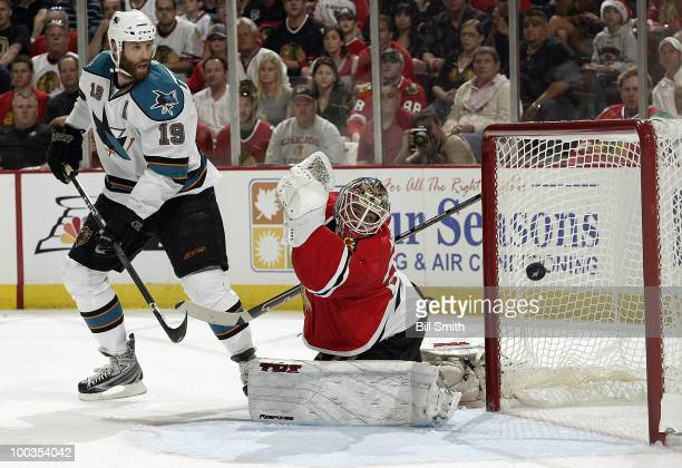 Goalie Antti Niemi of the Chicago Blackhawks fails to stop the puck scored by Logan Couture of the San Jose Sharks as Joe Thornton of the Sharks...