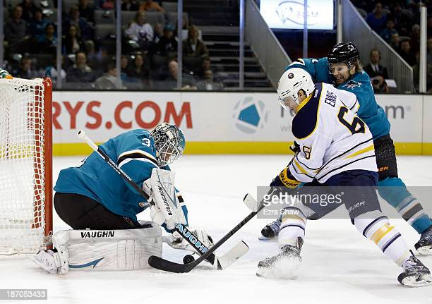 Goalie Antti Niemi of the San Jose Sharks and Brad Stuart stop Tyler Ennis of the Buffalo Sabres from scoring at SAP Center on November 5 2013 in San...