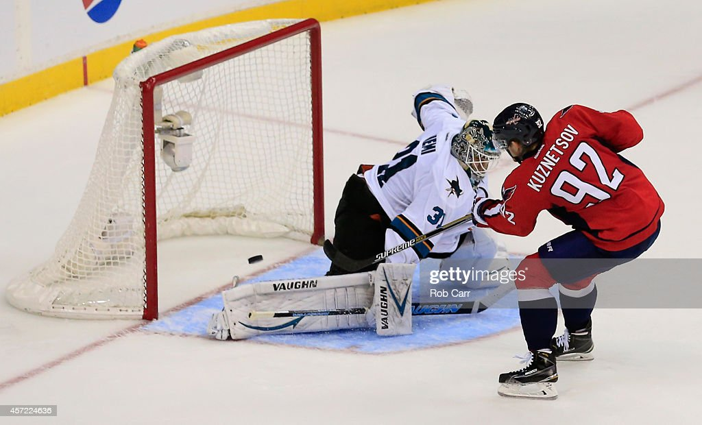 Goalie Antti Niemi #31 of the San Jose Sharks blocks a shot by Evgeny Kuznetsov #92 of the Washington Capitals during the Sharks 6-5 shootout win at Verizon Center on October 14, 2014 in Washington, DC.