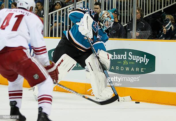Goalie Antti Niemi of the San Jose Sharks gets away from the net to clear the puck against Viktor Tikhonov of the Phoenix Coyotes in the first period...