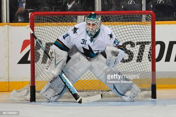 Goalie Antti Niemi of the San Jose Sharks warms up prior to a game against the Nashville Predators at Bridgestone Arena on January 7 2014 in...