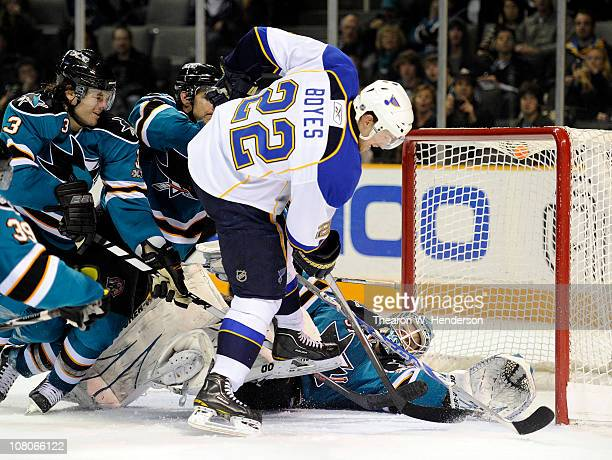 Goalie Antti Niemi the San Jose Sharks gets help from teammates Dan Boyle and Douglas Murray stopping the shot of Brad Boyes of the St Louis Blues in...