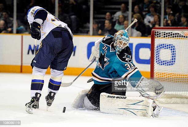 Goalie Antti Niemi the San Jose Sharks makes a save against the St. Louis Blues in the third period of an NHL hockey game at the HP Pavilion on...