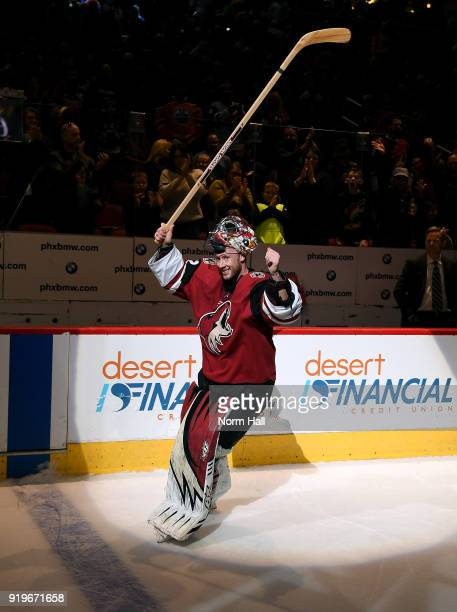 Goalie Antti Raanta of the Arizona Coyotes acknowledges the crowd following his 10 shutout victory against the Edmonton Oilers at Gila River Arena on...
