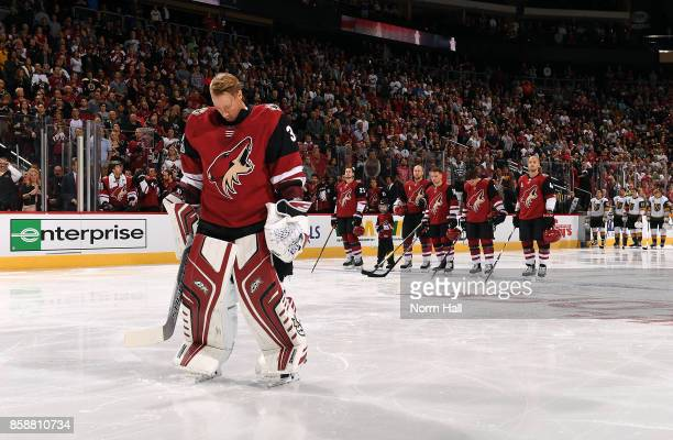 Goalie Antti Raanta of the Arizona Coyotes and teammates pause for a moment of silence to remember the victims of the Las Vegas shooting before a...