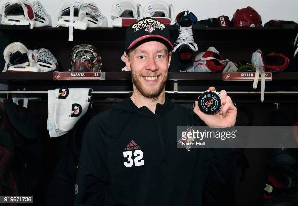 Goalie Antti Raanta of the Arizona Coyotes holds a game puck from his 10 shutout victory against the Edmonton Oilers at Gila River Arena on February...