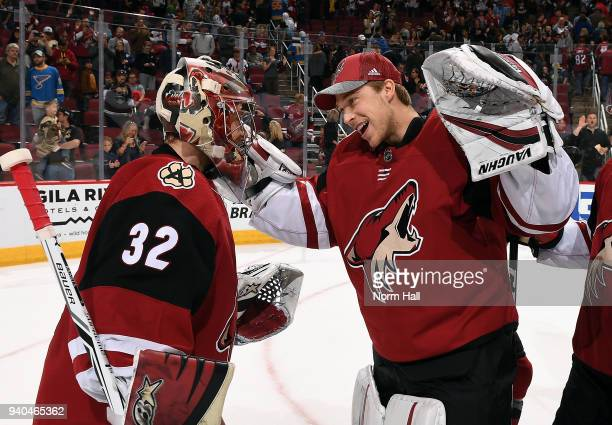Goalie Antti Raanta of the Arizona Coyotes is congratulated by teammate Darcy Kuemper after a 60 shutout victory against the St Louis Blues at Gila...