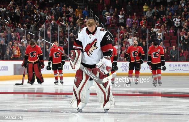 Goalie Antti Raanta of the Arizona Coyotes lowers his head during the national anthem prior to a game against the Calgary Flames at Gila River Arena...