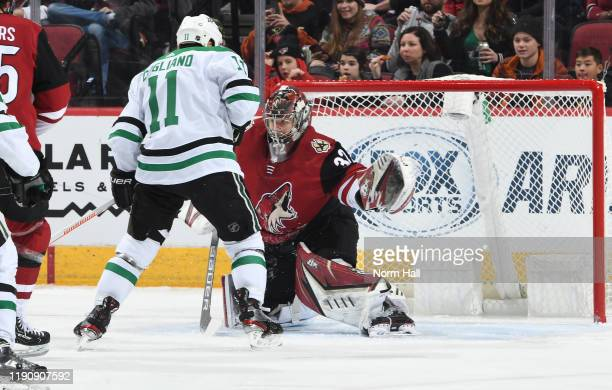 Goalie Antti Raanta of the Arizona Coyotes stops the puck on the scoring attempt by Andrew Cogliano of the Dallas Stars during the first period of...