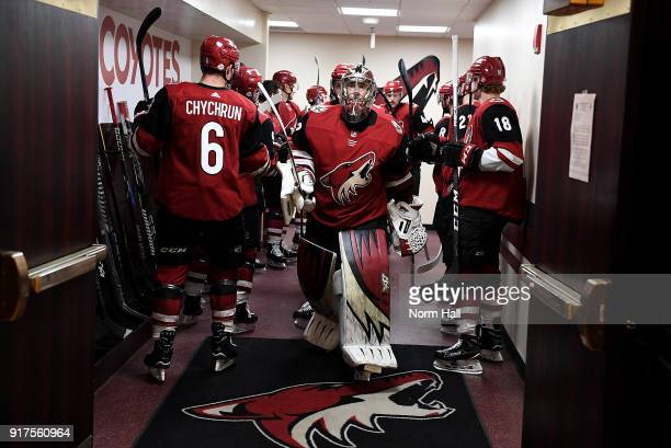 Goalie Antti Raanta of the Arizona Coyotes walks past teammates from the locker room prior to a game against the Chicago Blackhawks at Gila River...