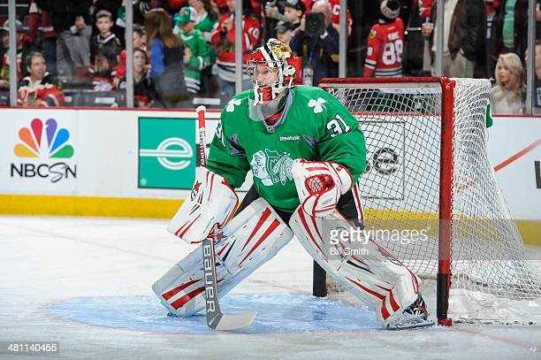Goalie Antti Raanta of the Chicago Blackhawks warms up prior to the NHL game against the Detroit Red Wings on March 16 2014 at the United Center in...