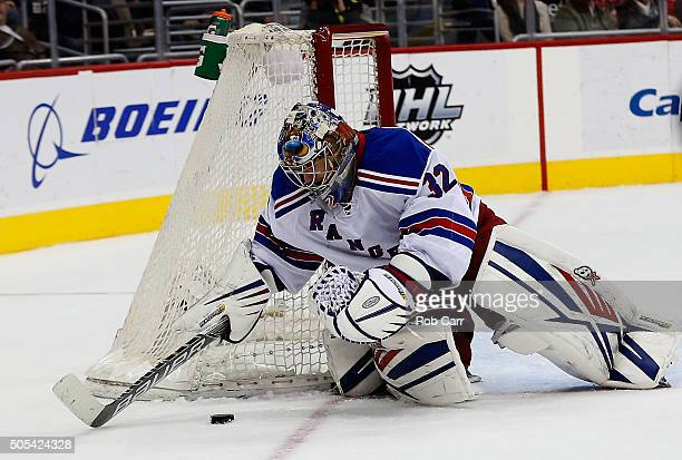Goalie Antti Raanta of the New York Rangers covers the puck in the second period against the Washington Capitals at Verizon Center on January 17 2016...