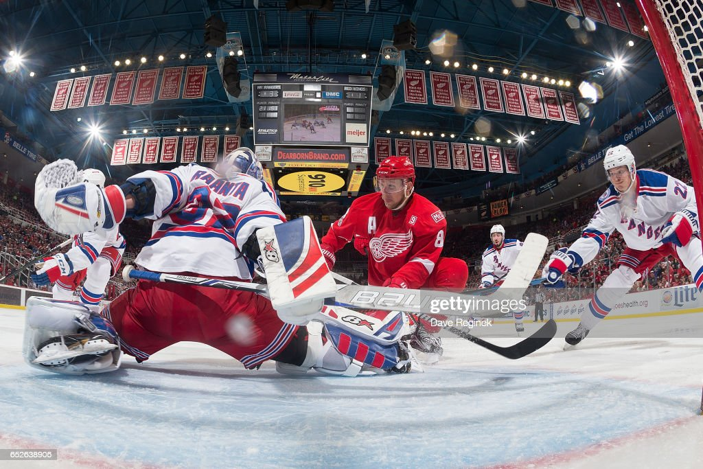 Goalie Antti Raanta #32 of the New York Rangers makes a save on Justin Abdelkader #8 of the Detroit Red Wings during an NHL game at Joe Louis Arena on March 12, 2017 in Detroit, Michigan. The Rangers defeated the Wings 4-1.