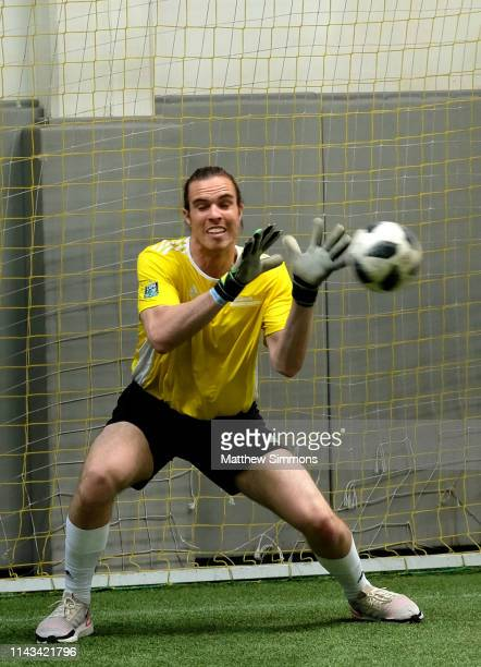 A goalie attempts to block a shot during the Copa Del Rave Charity Soccer Tournament at Evolve Project LA on April 17 2019 in Los Angeles California