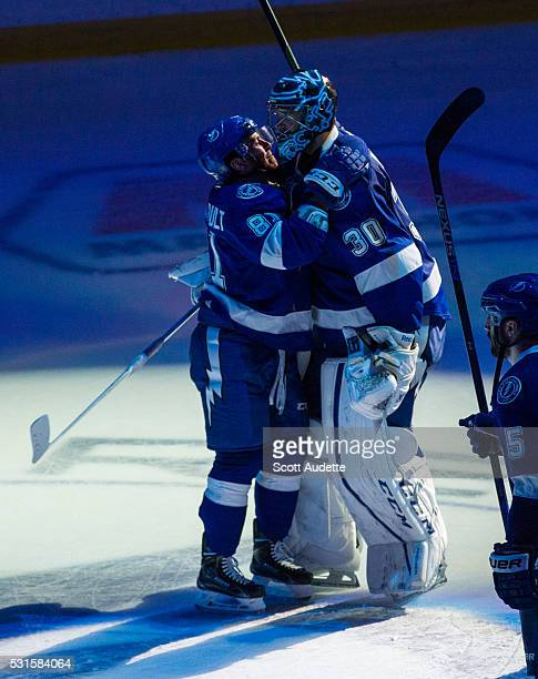 Goalie Ben Bishop and Jonathan Marchessault of the Tampa Bay Lightning celebrates the series win against the New York Islanders after Game Five of...