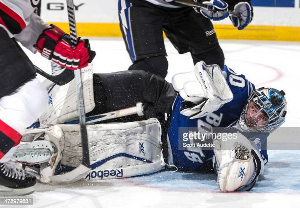 Goalie Ben Bishop of the Tampa Bay Lightning looks for the puck against the New Jersey Devils during the second period at the Tampa Bay Times Forum...