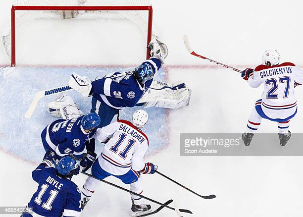 Goalie Ben Bishop of the Tampa Bay Lightning makes a save against Alex Galchenyuk of the Montreal Canadiens during the first period at the Amalie...