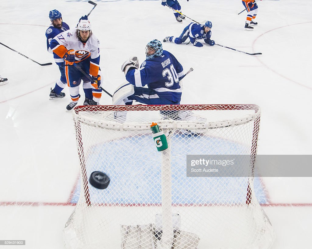 Goalie Ben Bishop #30 of the Tampa Bay Lightning watches the puck against Matt Martin #17 of the New York Islanders after Game Five of the Eastern Conference Second Round in the 2016 NHL Stanley Cup Playoffs at the Amalie Arena on May 8, 2016 in Tampa, Florida.