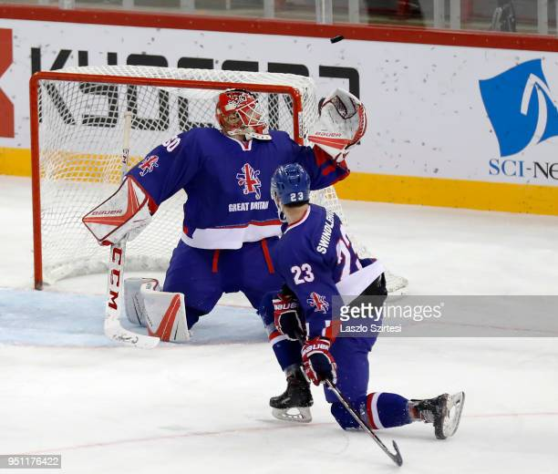 Goalie Ben Bowns of Great Britain watches the puck next to Paul Swindlehurst of Great Britain during the 2018 IIHF Ice Hockey World Championship...