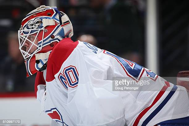 Goalie Ben Scrivens of the Montreal Canadiens defends the goal against the Colorado Avalanche at Pepsi Center on February 17 2016 in Denver Colorado...