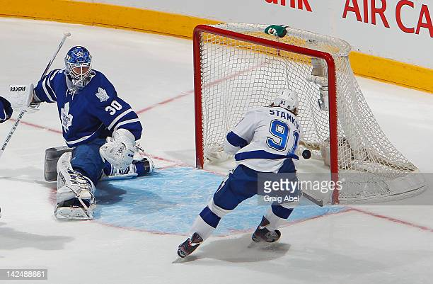 Goalie Ben Scrivens of the Toronto Maple Leafs looks on as Steven Stamkos of the Tampa Bay Lightning scores his 59th goal of the season during NHL...