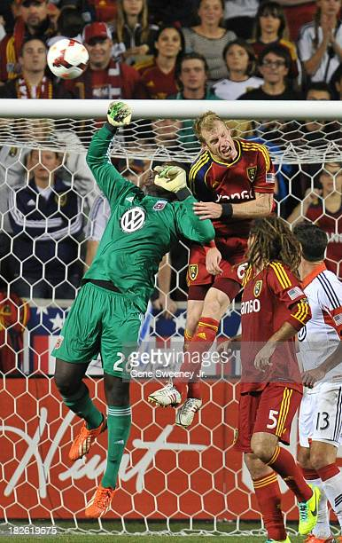 Goalie Bill Hamid of DC United blocks the shot by Nat Borchers of Real Salt Lake at Rio Tinto Stadium October 1 2013 in Sandy Utah