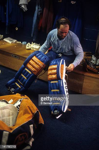 Goalie Billy Smith of the New York Islanders gets ready in the locker before an NHL game in October 1983 at the Nassau Coliseum in Uniondale New York