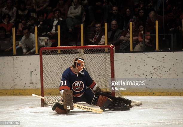 Goalie Billy Smith of the New York Islanders makes the kick save during an NHL game against the New York Rangers on December 26 1976 at the Madison...