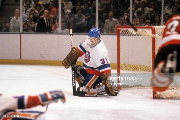 Goalie Billy Smith of the New York Islanders makes the save during the 1980 Stanley Cup Finals against the Philadelphia Flyers in May 1980 at the...