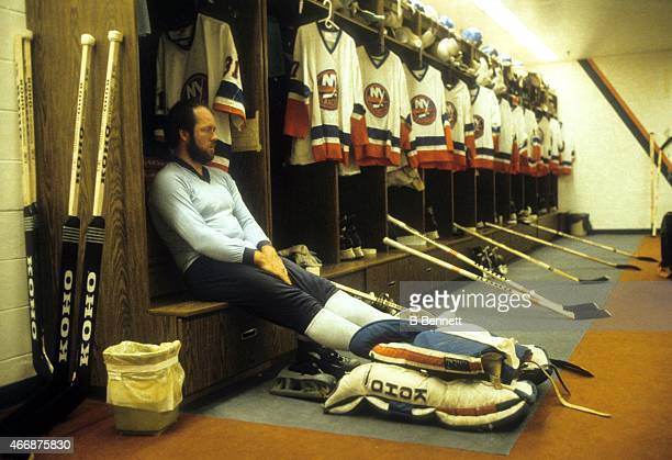 Goalie Billy Smith of the New York Islanders sits in his stall in the locker before an NHL game in October 1984 at the Nassau Coliseum in Uniondale...