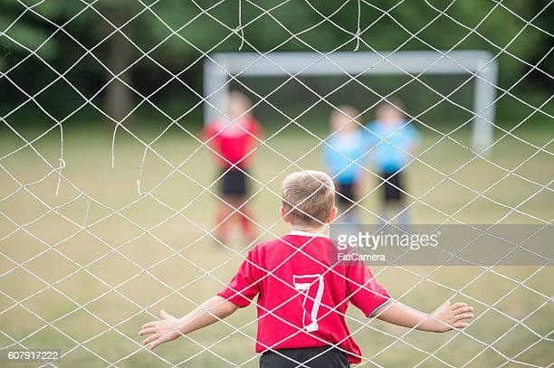 goalie blocking the net - fat soccer players foto e immagini stock
