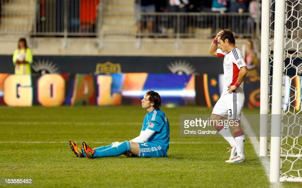 Goalie Bobby Shuttleworth and Ryan Guy of the New England Revolution react after Jack McInerney of the Philadelphia Union scored the game winning...