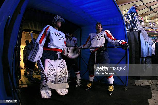 Goalie Braden Holtby and Alex Ovechkin of the Washington Capitals look on from the tunnel prior to taking the ice to play against the New York...