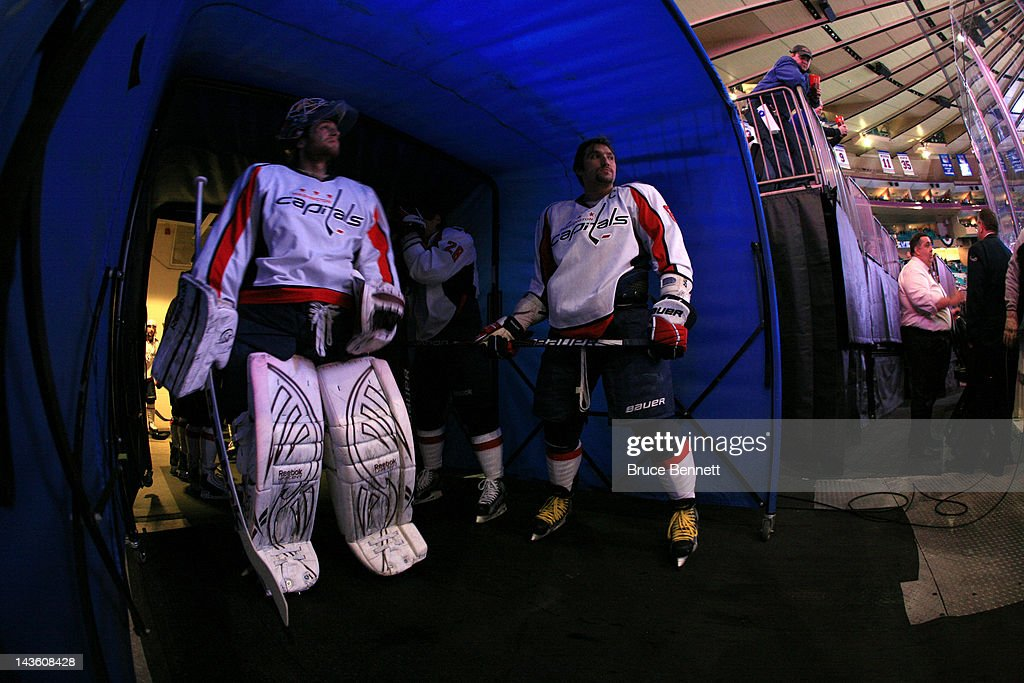 Goalie Braden Holtby #70 and Alex Ovechkin #8 of the Washington Capitals look on from the tunnel prior to taking the ice to play against the New York Rangers in Game Two of the Eastern Conference Semifinals during the 2012 NHL Stanley Cup Playoffs at Madison Square Garden on April 30, 2012 in New York City.